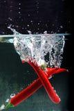 Chili in water splash Stock Photos