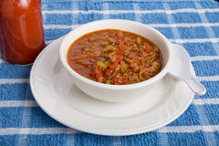Chili in White Bowl with Spoon and Hot Sauce Royalty Free Stock Photos