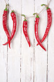 Chili. On a white wooden background Stock Photos