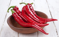 Chili. On a white wooden background Royalty Free Stock Photo