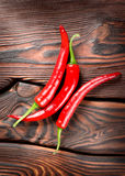 Chili on a wooden background Royalty Free Stock Photo