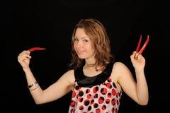chilies держа женщину Стоковая Фотография