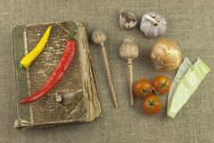 Chilies with an old recipe book. Vegetables ready for home cooking. Stock Image