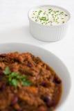 chiligräslökar lagar mat med grädde surt Royaltyfri Foto