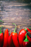 Chilipeppar på en tabell Royaltyfria Bilder