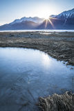Chilkat ice pond at sunset Royalty Free Stock Image