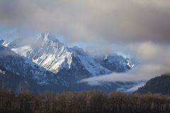 Chilkat mountains with clearing fog Royalty Free Stock Image