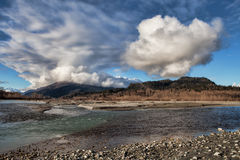 Chilkat River with clouds Royalty Free Stock Photos