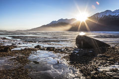 Chilkat River sunset with ice. Royalty Free Stock Photo