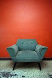 Chill Chair. A well worn chair set against an orange wall in a room in Mexico Royalty Free Stock Photos