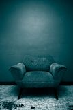 Chill Chair. A well worn chair set against a wall in a room in Mexico Royalty Free Stock Photography