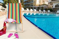 Chill. Ing summer retro frame effect deckchair stock photos