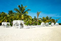 Chill lounge zone. On the sandy beach, Maldives island Royalty Free Stock Image