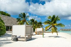 Chill lounge zone. On the sandy beach, Maldives island Royalty Free Stock Photo