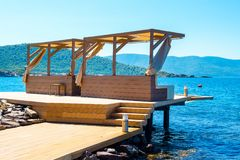 Chill lounge zone on the beach. Chill lounge zone on the rocky beach, Bodrum, Turkey Stock Images