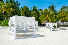 Chill lounge zone. On the sandy beach, Maldives island Royalty Free Stock Images