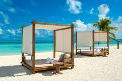 Chill lounge zone. On the sandy beach, Maldives island Stock Photos