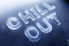 Chill Out. Words Chill Out made of real ice letters on ice background Royalty Free Stock Photos
