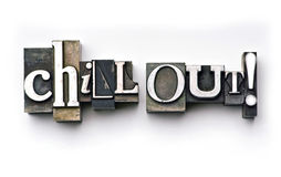 Chill Out!. The words Chill Out! done in letterpress type on a white paper background royalty free stock images