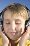 Chill out at the beach. Listening to favourite tracks at the beach - closeup Stock Photos