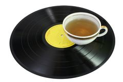 Chill out music. Vinyl disc and tea - isolated on white stock image