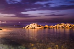 Chill Out Rocky Shoreline Sunset. Relaxing shoreline during sunset with beautiful colors in Marmara sea of the country Turkey. Early summer sunsets are the most Stock Photos