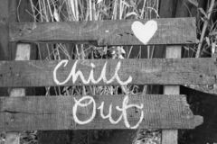 Chill out sign. Chill out words hand painted on boards.Positive garden decoration element.Cool sign.Insprational quotee,text.Uk lifestyle.Relaxing athmosphere royalty free stock image
