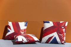 Chill out zone with british colors cushions and orange wall Royalty Free Stock Images