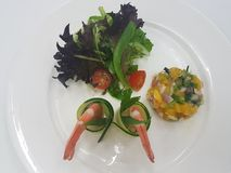 Chilled Prawn Cocktail with Mango Salsa and Mesclun Mix on white plate. Chill Prawn Cocktail with Mango Salsa Royalty Free Stock Images