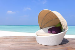 Chill. Relax and chill in this deck chair. Enjoy a cocktail or a good book by the beach in the Maldives stock photos