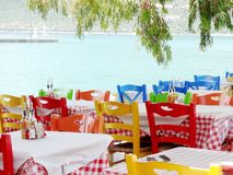 Chill traveling around the beach in Lefkada, Greece. Relax and comfortable restaurant with colorful chairs and nice weather. royalty free stock photos