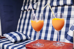 Chilled aperol at beach chair in garden Royalty Free Stock Images