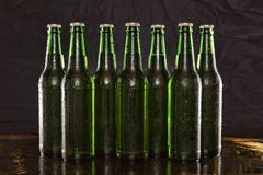 Chilled beer, alcohol, background, bar, beer, beverage, black, brew, Summer party. Closeup of Chilled beer. Brewed beer in bottles on wooden table on black stock images