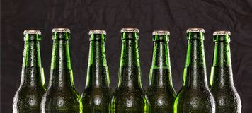 Chilled beer, alcohol, background, bar, beer, beverage, black, brew, Summer party. Closeup of Chilled beer. Brewed beer in bottles on wooden table on black stock photo