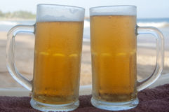 Chilled beer on a sunny day at the beach Royalty Free Stock Photo