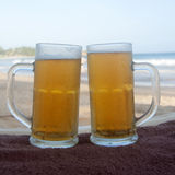 Chilled beer on a sunny day at the beach Royalty Free Stock Image