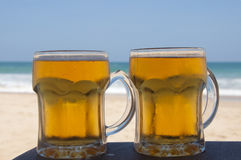 Chilled beer on a sunny day at the beach Stock Photography