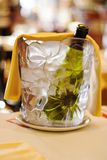 Chilled bottle of wine in a bucket with ice. On bokeh background royalty free stock images