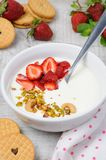 Chilled Buttermilk soup. From Greek yogurt with strawberries and pistachios, cashews. Serve with crispy biscuits. Vertical shot Royalty Free Stock Images