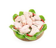Chilled chicken wings in a circle on wooden. And white plate Studio isolation Royalty Free Stock Photo