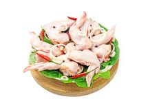 Chilled chicken wings exhibited in the circle. On white background Royalty Free Stock Images