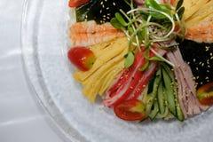 Chilled cold cool somen noodle. japanese food with ham egg seawe. Ed shrimp & vegetable royalty free stock image