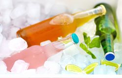 Chilled colorful beverages in ice box. summer party. Chilled colorful bottled beverages in ice box. summer party royalty free stock images