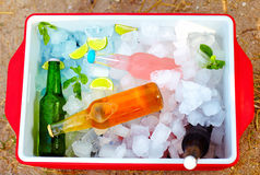 Chilled colorful beverages in ice box. summer party. Chilled colorful beverages in ice box with mint. summer party stock photography