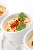 Chilled Corn and Bacon Soup. Three bowls of Chilled Corn and Bacon soup garnished with cooked bacon, fresh cilantro, and smoked paprika royalty free stock photos