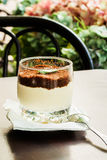 Chilled dessert of coffee and chocolate, small glass on the terrace during summer Royalty Free Stock Photography