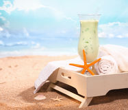 Chilled drink and some bath towels Royalty Free Stock Photo