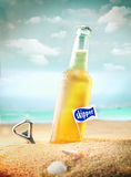Chilled fruity soda or ale on the beach Stock Images