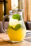 Chilled juice with ice and mint. A refreshing drink in a jar on the table. Chilled juice with ice and mint Royalty Free Stock Photography