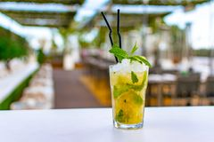 A chilled lime green mojito cocktail royalty free stock images